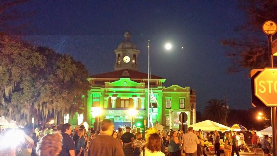 Courthouse lit up in green lighting