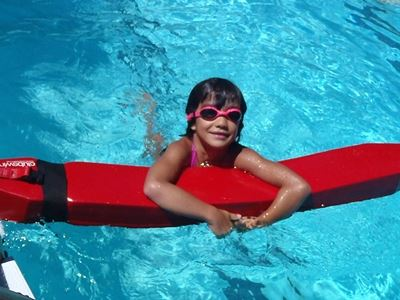 Young Girl on Lifeguard Float for Junior Lifequard Training